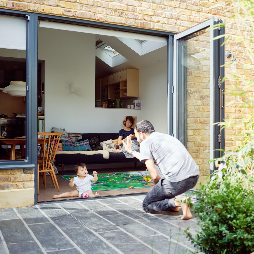 Rohit, Emma and Uma at home in South London – photographed for Project Living Abroad